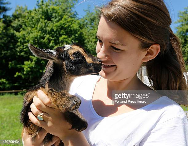 Lila Hall holds Radish one of her family's baby goats A video that she made with her sister Tess of them running with the baby goats has become a...