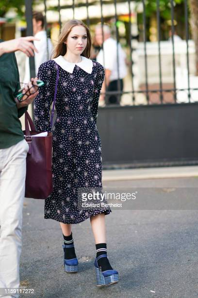 Lila Moss wears a dress with polka dots printed features and a white collar blue shoes outside Miu Miu Club 2020 on June 29 2019 in Paris France