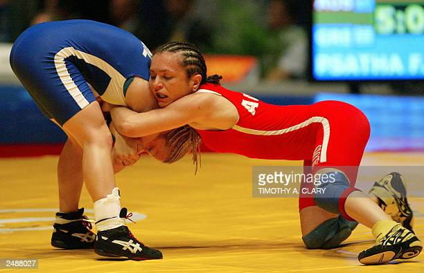Lila Ristevska of Australia and Fani Psatha of Greece compete during their match in round one of the Women's 48 kg category at the World Championship...