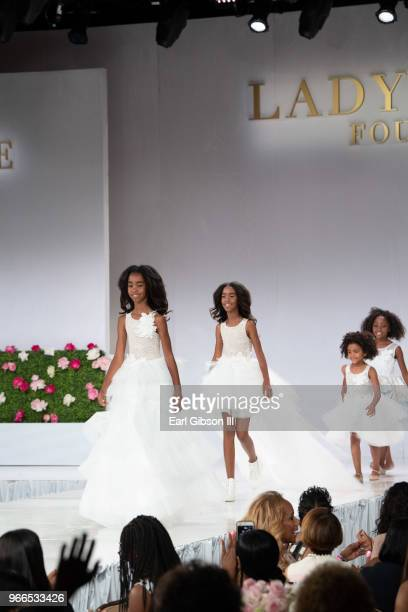 D'Lila Star Combs and Jessie James Combs walk the catwalk at the Ladylike Foundation's 2018 Women Of Excellence Scholarship Luncheon at The Beverly...