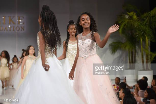 D'Lila Star Combs Chance Combs and Jessie James Combs walk onstage during The LadyLike Foundation Women Of Excellence Luncheon at The Beverly Hilton...
