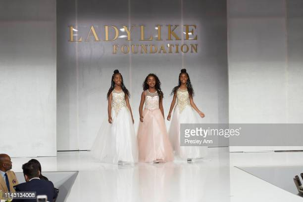 D'Lila Star Combs Jessie James Combs and Chance Combs walk onstage during The LadyLike Foundation Women Of Excellence Luncheon at The Beverly Hilton...