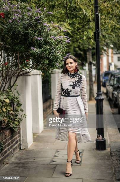 Lilah Parsons seen wearing 8th Sign dress HM earrings Monsoon handbag and Giuseppe Zanotti shoes on Day 5 of London Fashion Week September 2017 on...