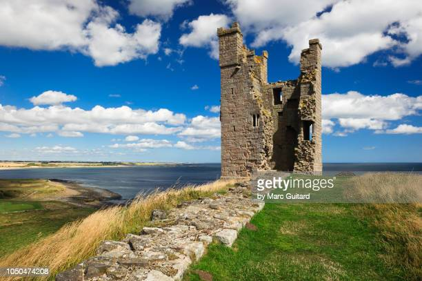 lilburn tower, dunstanburgh castle, northumberland, england - england stock pictures, royalty-free photos & images