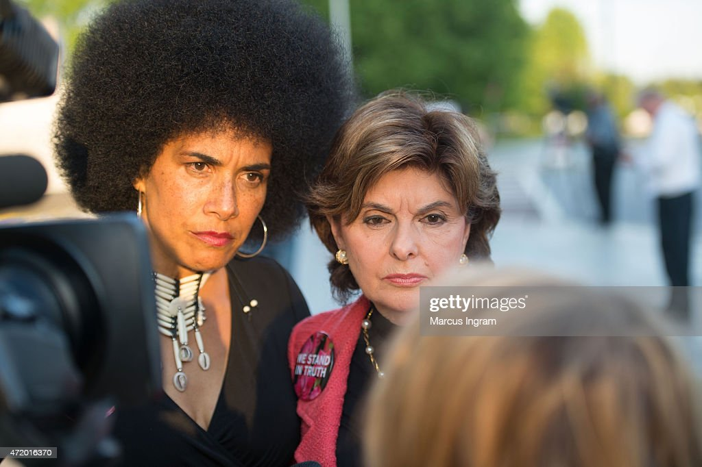 Lili Bernard and Gloria Allred with protestors outside of Bill Cosby's 'Far from Finished' Tour at Cobb Energy Performing Arts Center on May 2, 2015 in Atlanta, Georgia.