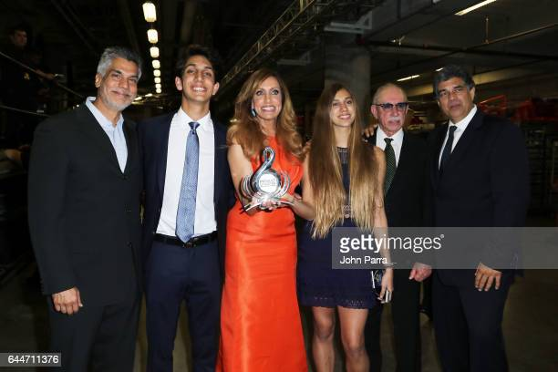 Lili Estefan poses with her family on the backstage of Univision's 29th Edition of Premio Lo Nuestro A La Musica Latina at the American Airlines...