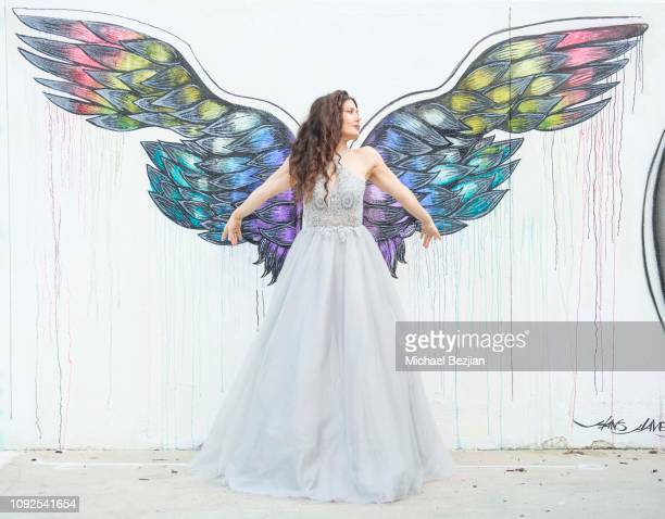 Lili Hayden poses by Gracie Kim Art and wearing a Dalia Macphee dress at Giveback Day at TAP The Artists Project on January 10 2019 in Los Angeles...
