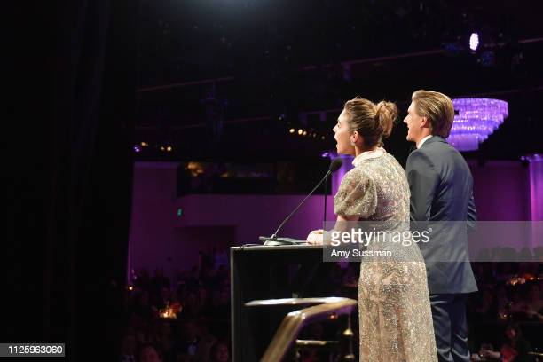 Lili Mirojnick and Chris Lowell speak onstage during The 21st CDGA at The Beverly Hilton Hotel on February 19 2019 in Beverly Hills California