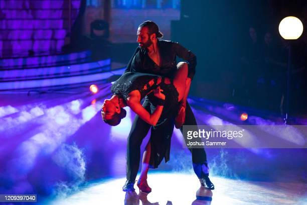 """Lili Paul-Roncalli and Massimo Sinato perform on stage during the 1st show of the 13th season of the television competition """"Let's Dance"""" on February..."""