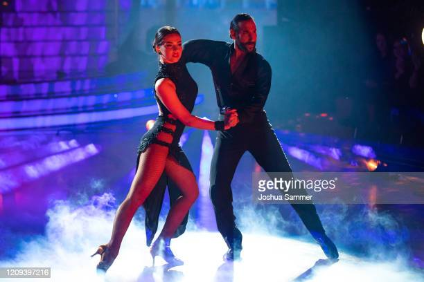 Lili PaulRoncalli and Massimo Sinato perform on stage during the 1st show of the 13th season of the television competition Let's Dance on February 28...