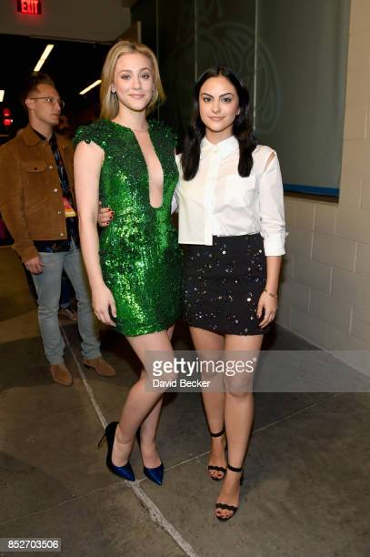 Lili Reinhart and Camila Mendes attend the 2017 iHeartRadio Music Festival at TMobile Arena on September 23 2017 in Las Vegas Nevada