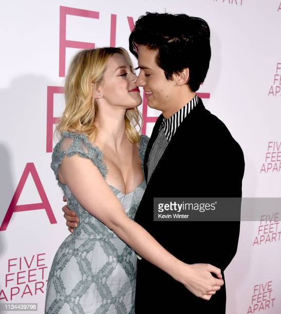Lili Reinhart and Cole Sprouse arrive at the premiere of CBS Films' Five Feet Apart at the Fox Bruin Theatre on March 07 2019 in Los Angeles...