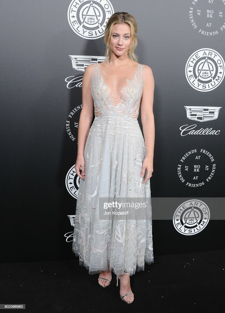 Lili Reinhart attends The Art Of Elysium's 11th Annual Celebration - Heaven at Barker Hangar on January 6, 2018 in Santa Monica, California.