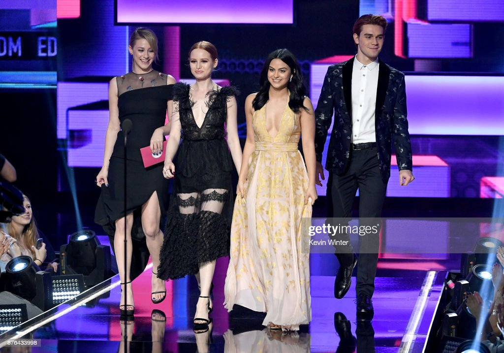 Lili Reinhart, Madelaine Petsch, Camila Mendes, and KJ Apa walk onstage during the 2017 American Music Awards at Microsoft Theater on November 19, 2017 in Los Angeles, California.