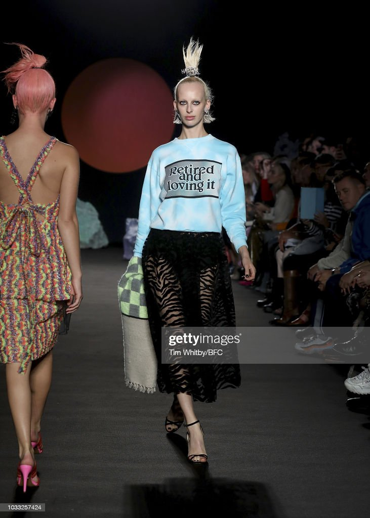Lili Sumner walks the runway at the Ashley Williams presentation during London Fashion Week September 2018 at the House of Vnas on September 14, 2018 in London, England.