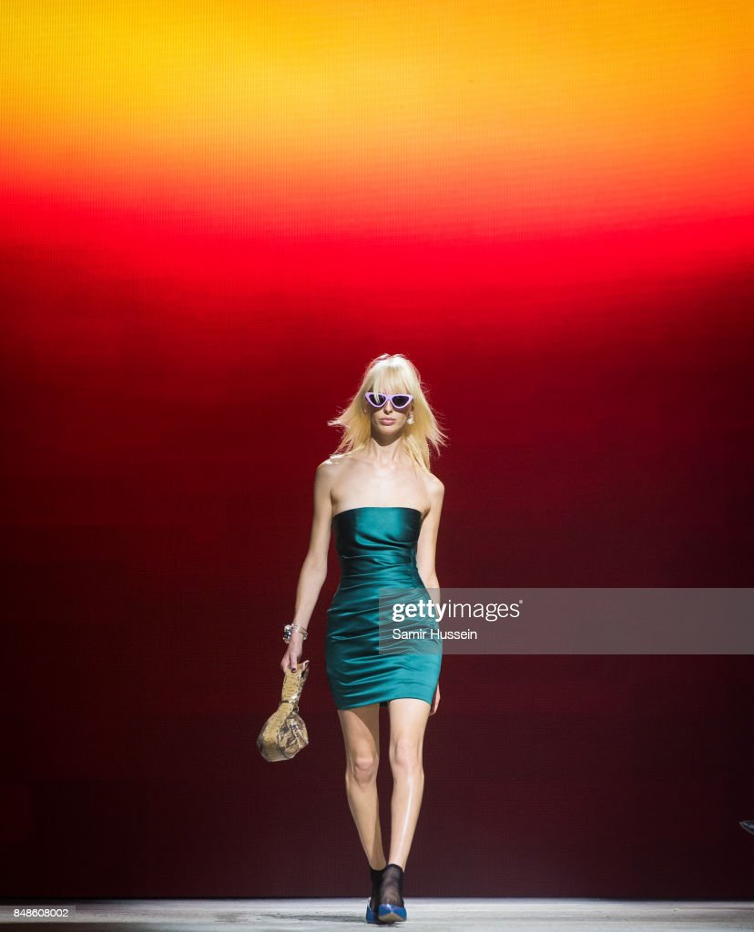 Lili Sumner walks the runway at the TOPSHOP show during London Fashion Week September 2017 on September 17, 2017 in London, England.