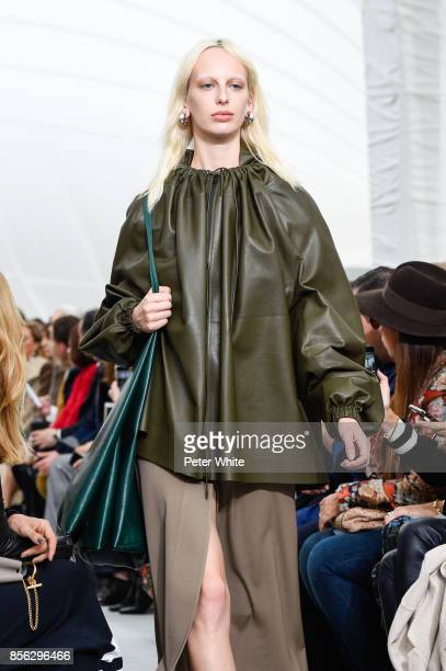 Lili Sumner walks the runway during the Celine show as part of the Paris Fashion Week Womenswear Spring/Summer 2018 on October 1 2017 in Paris France