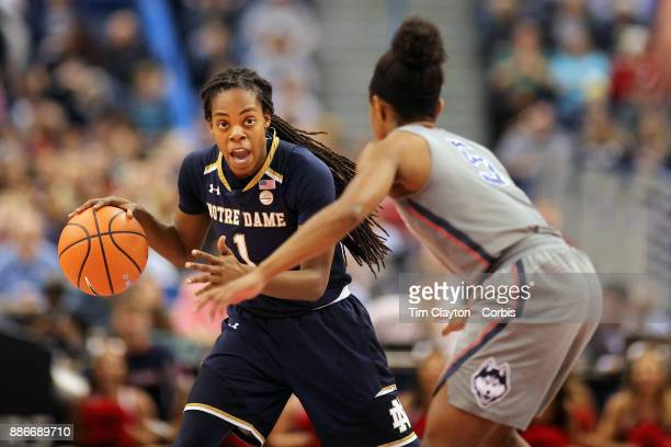 Lili Thompson of the Notre Dame Fighting Irish defended by Crystal Dangerfield of the Connecticut Huskies during the the UConn Huskies Vs Notre Dame...