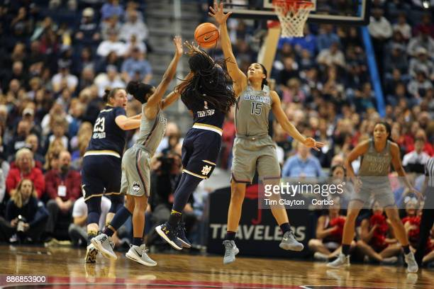 Lili Thompson of the Notre Dame Fighting Irish feeds a pass to team mate Jessica Shepard of the Notre Dame Fighting Irish while defended by Crystal...