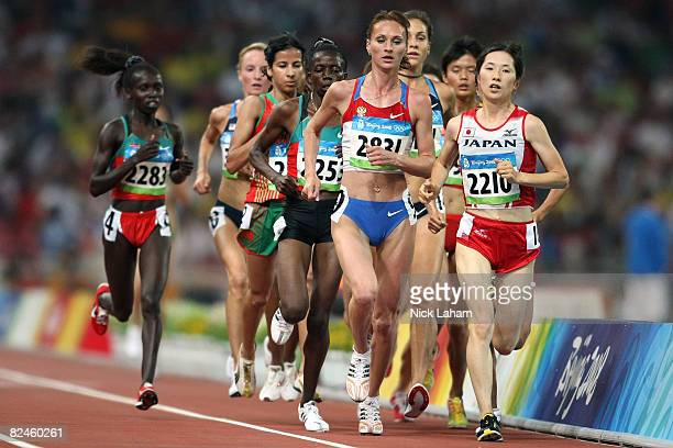 Lilia Shobukhova of Russia and Yukiko Akaba of Japan compete in the Women's 5000m Heats held at the National Stadium on Day 11 of the Beijing 2008...