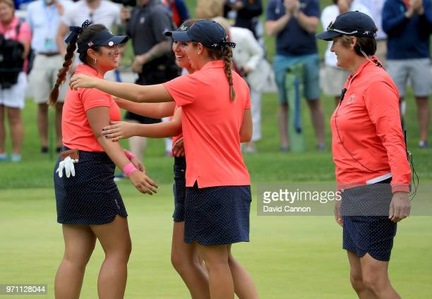 Lilia Vu of the United States team is congratulated by team players Kristen Gillman and Andrea Lee as captain Virginia Derby Grimes watches on the...