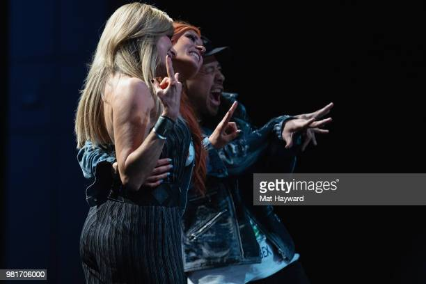 Lilian Garcia Becky Lynch and Shinsuke Nakamura pose for a photo during ACE Comic Con on June 22 2018 at WaMu Theatre in Seattle Washington