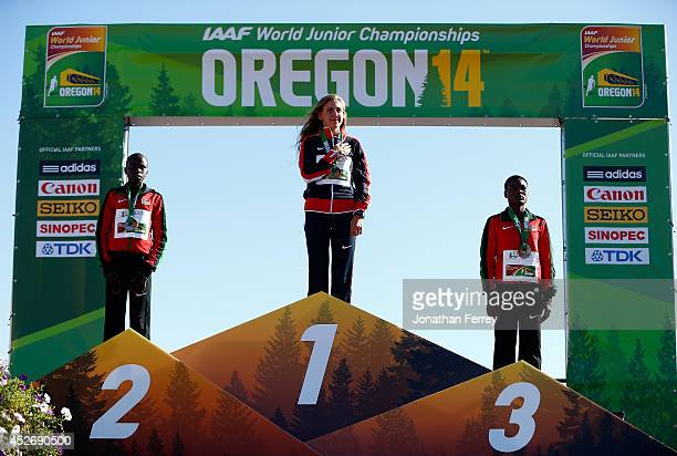 Lilian Kasait Rengeruk of Kenya Mary Cain of USA and Valentina Chepkwemoi Mateiko of Kenya pose during the medals ceremony for the women's 3000m on...