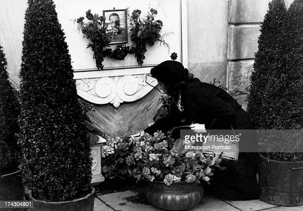 Lilian Sacchi takes some flowers to the tomb of her husband Carlo shot dead with a 9mm caliber revolver by his lover Pia Bellentani on the 15th...