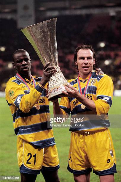 Lilian Thuram and Alain Boghossian with trophy after Parma's 30 victory over Olympique Marseille in the 19981999 UEFA Cup Final