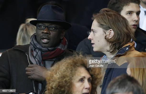 Lilian Thuram and Pierre Sarkozy attend the UEFA Champions League round of 16 match between Paris SaintGermain FC and Chelsea FC at Parc des Princes...