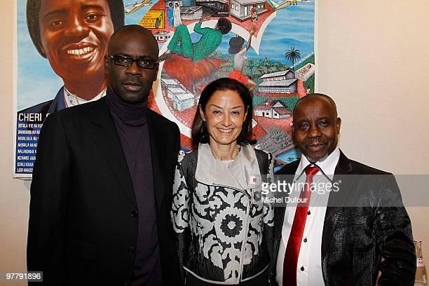 Lilian Thuram Cristina OwenJones and Cheri Samba attend the Association Dessine l'Espoir Charity Dinner during Art Paris Exhibition Launch at Grand...