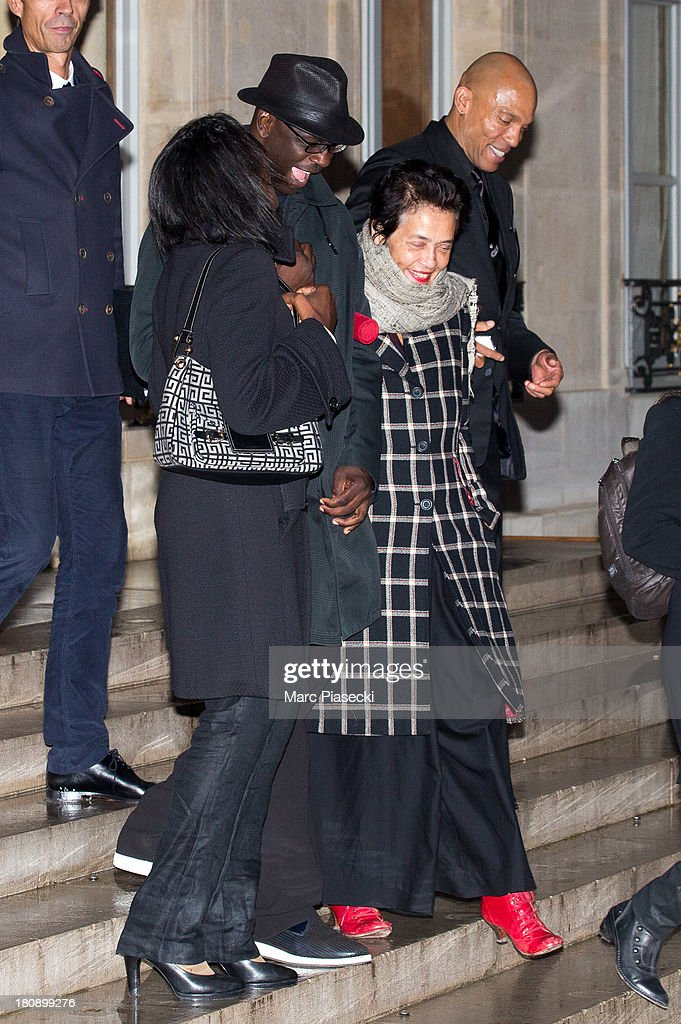 Lilian Thuram (C) leaves the 'Elysee' Palace after receiving the 'officier de la legion d'honneur' medal at Elysee Palace on September 17, 2013 in Paris, France.