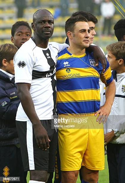 Lilian Thuram of Stelle Crociate and Fabio Cannavaro of Stelle Gialloblu at the end of the 100 Years Anniversary match between Stelle Crociate and US...