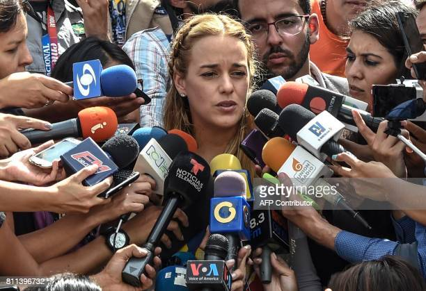 Lilian Tintori, wife of Venezuelan political prisoner and opposition leader Leopoldo Lopez, speaks to the press during a demonstration marking 100...