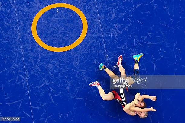 Liliana Costa dos Santos and Mariya Stadnyk of Azerbaijan compete in the Women's wrestling 48kg Freestyle 1/8 Final match during day three of the...