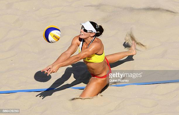 Liliana Fernandez Steiner of Spain dives for the ball during the Women's Beach Volleyball preliminary round Pool B match against Georgina Klug and...