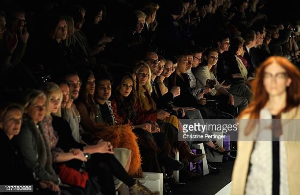 Liliana Mattaeus and Nazan Eckes watch a model walk the runway at the Rebekka Ruetz Autumn/Winter 2012 fashion show during Mercedes-Benz Fashion Week...