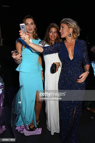 Liliana Matthaeus and Hofit Golan attend the amfAR Milano 2014 Gala Dinner and Auction as part of Milan Fashion Week Womenswear Spring/Summer 2015 on...
