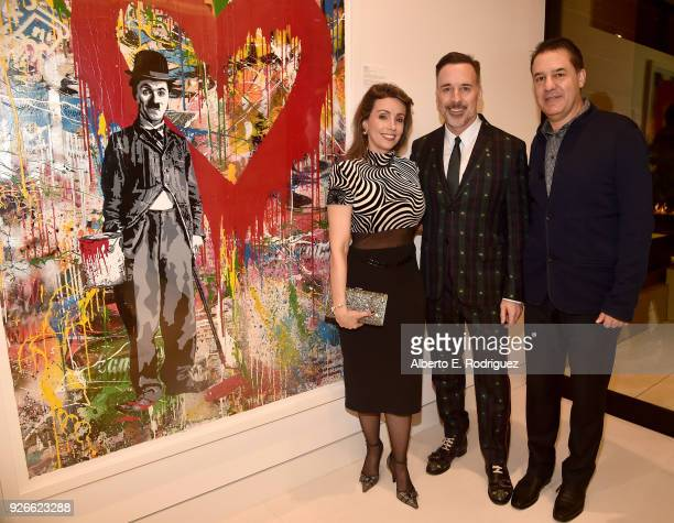Liliana Molina David Furnish and Mauricio Vallejo attend a cocktail party hosted by the Elton John AIDS Foundation and BBVA Compass to celebrate EJAF...