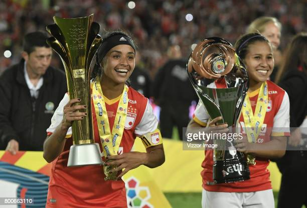 Liliana Salazar and Leicy Santos of Independiente Santa Fe celebrate with the trophy after winning a second leg match between Independiente Santa Fe...