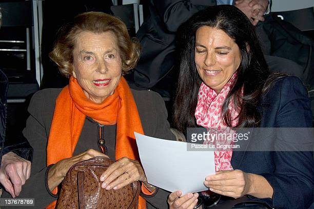 Liliane Bettencourt and her daughter Francoise BettencourtMeyers attend the Giorgio Armani Prive HauteCouture Spring / Summer 2012 show as part of...