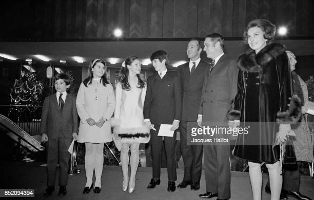 Liliane Bettencourt with Sargent Shriver, the USA ambassador in France and his children, Maria, Anthony and Timothy in Paris, 20th December 1968