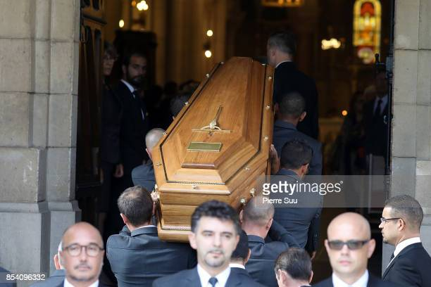 Liliane Bettencourt's coffin is carried into the ceremony during her funeral at Eglise Saint Pierre on September 26 2017 in NeuillysurSeine France