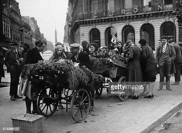 Lilies of the valley made their usual appearance today on the boulevards of Paris in honor of May Day Photo shows people buying the flowers this...