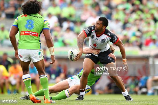 Liligiifo Sao of the Warriors offloads during the round three NRL match between the Canberra Raiders and the New Zealand Warriors at GIO Stadium on...