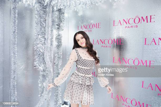 Lilimar attends Lancôme x Vogue Holiday Event at Delilah West Hollywood on November 29 2018 in West Hollywood California