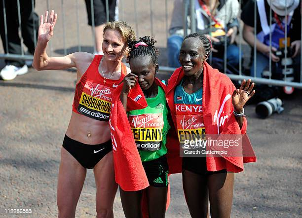 Liliya Shobukhova, Mary Keitany and Edna Kiplagat pose after crossing the finish line of the Womens Elite section of the 2011 Virgin London Marathon...