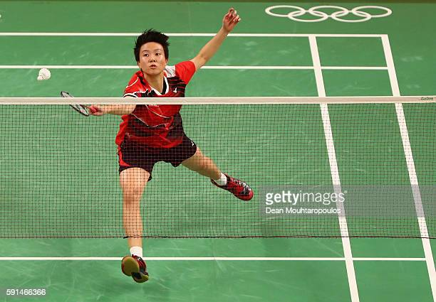 Liliyana Natsir of Indonesia competes during the Mixed Doubles Gold Medal Match against Peng Soon Chan and Liu Ying Goh of Malaysia on Day 12 of the...