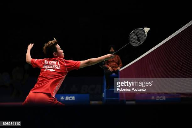 Liliyana Natsir of Indonesia partnered with Tontowi Ahmad compete against Chan Peng Soon and Yen Wei Peck of Malaysia during Mixed Double Semifinal...