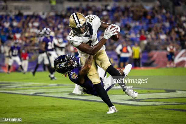 Lil'Jordan Humphrey of the New Orleans Saints scores touchdown against Anthony Averett of the Baltimore Ravens during second quarer of a preseason...